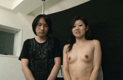 Japanese av model. Japanese AV Model fondles her boobs while
